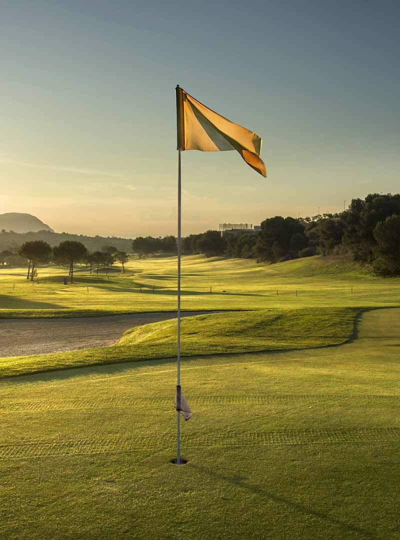 a flag flying on the 12th green at Alenda Golf