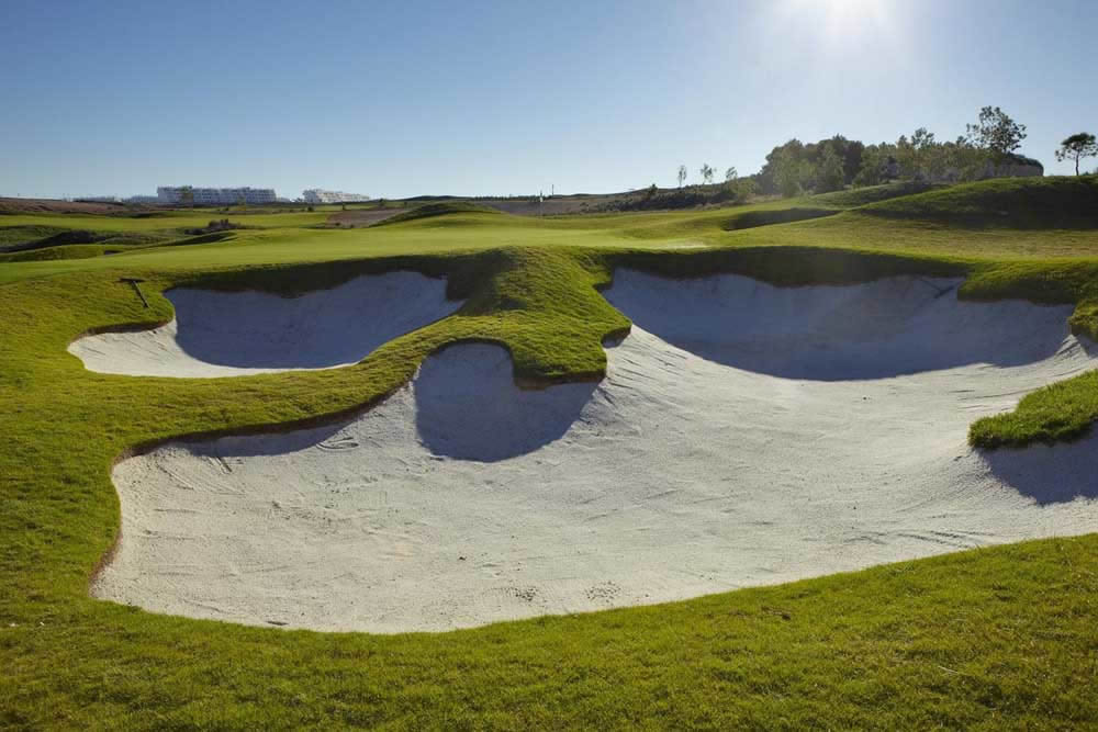 strategicall placed bunkers guard the 12th green at Alhama