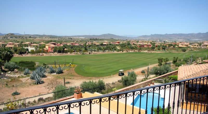 view of the golf course from a rooftop terrace