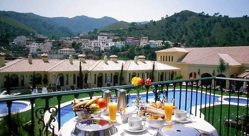 breakfast on the balcony overlooking the swimming pool