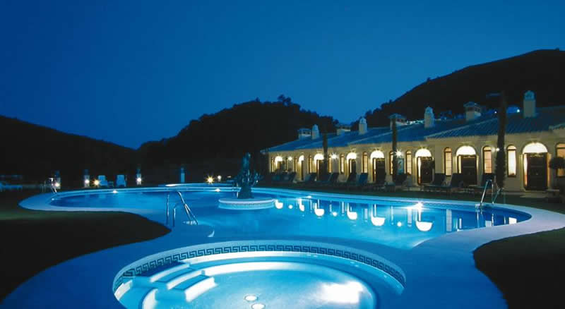 the hotel and swimming pool by night