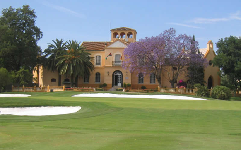 the guadalhorce golf clubhouse and the 18th green