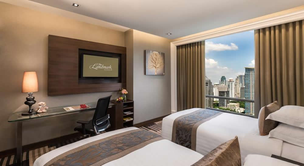 a view of Bangkok from a bedroom