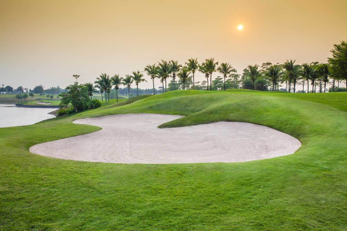 large bunkers and lakes abound on the pattana golf course