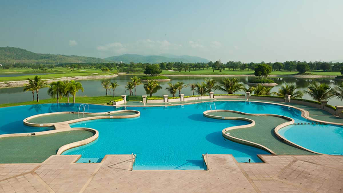 the huge outdoor pool with the golf course in the background