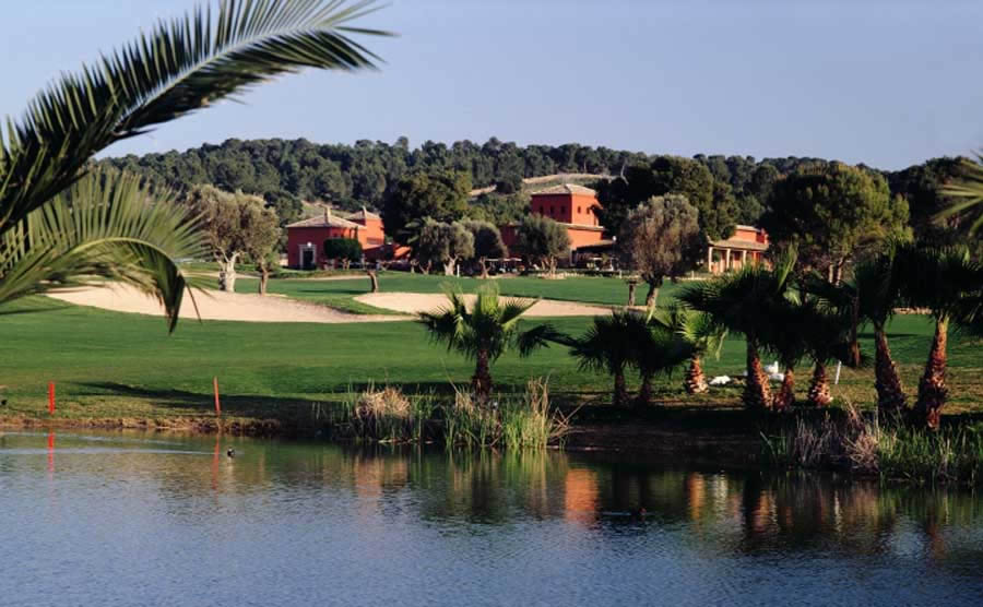 a lake bordering the fairway at poniente