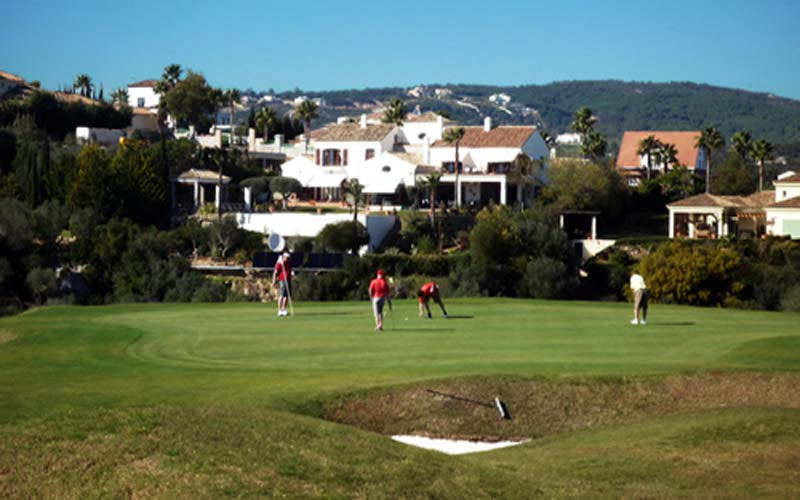 puttting on the 6th green at san roque new course