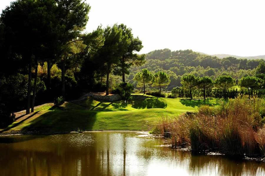a lake guarding the 10th green at son muntaner golf course, mallorca