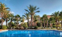 the outdoor swimming pool at the husa alicante golf hotel