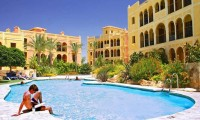a group of apartments and a shared swimming pool at the Lodge - Desert Springs Golf Resort in Almeria