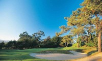 a bunker guards the 8th green at Estoril Palacio Golf Club