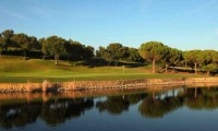 a lake guards the green at la reserva golf club
