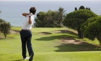 golfer teeing off on the 2nd hole at Llavaneras Golf Club