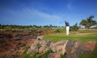 teeing off at meloneras golf