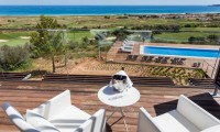 a balcony with stunning views of the Palmares golf course