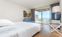 a beautiful sea view from a bedroom of the Onyria Palmares Beach House Hotel