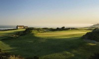 the 12th green with the atlantic ocean in the background