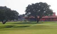 the 18th green with the santo estevao clubhouse behind it.