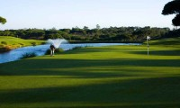 a golfer putting on the 6th green at vale do lobo royal course