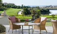 a terrace overlooking the golf course - villa padierna palace hotel, costa del sol, spain
