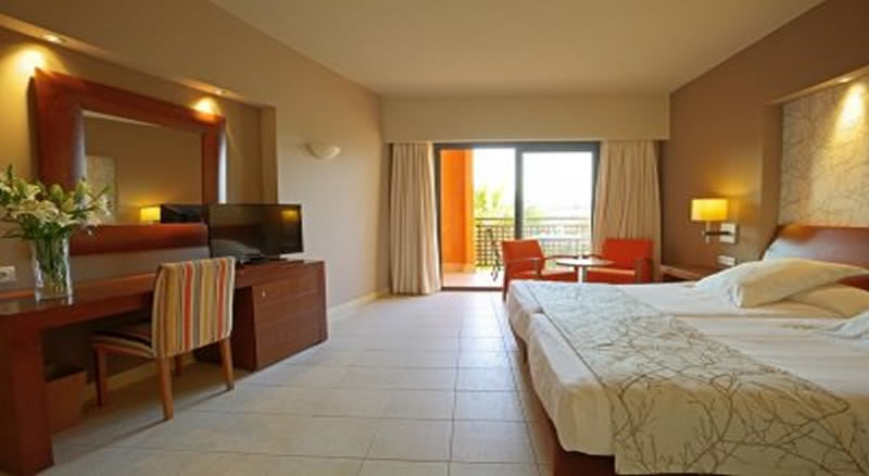 a double bedroom at the valle del este golf resort hotel