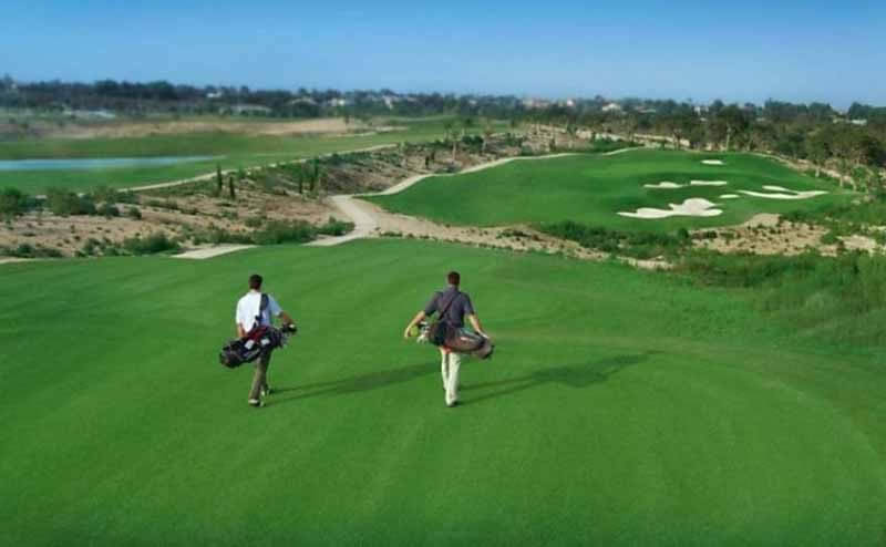 golfers walking down the first fairway of the villaitana levante golf course